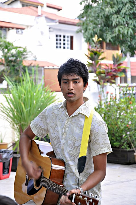Handsome guy playing guitar