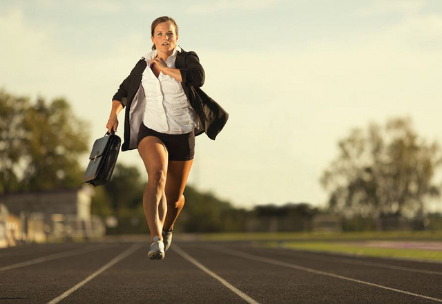 Woman in a suit running for success