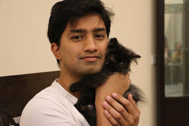riaz with his kitten Oreo