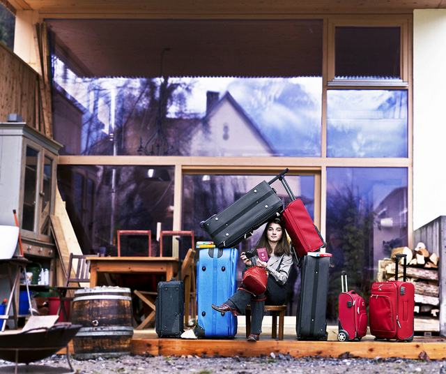 girl travelling with lots of baggages