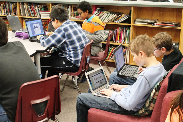 Students learning about SEO on their laptops