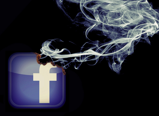 Facebook logo burning away slowly