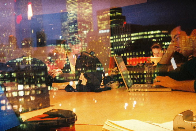 student studying with the night life view of the city