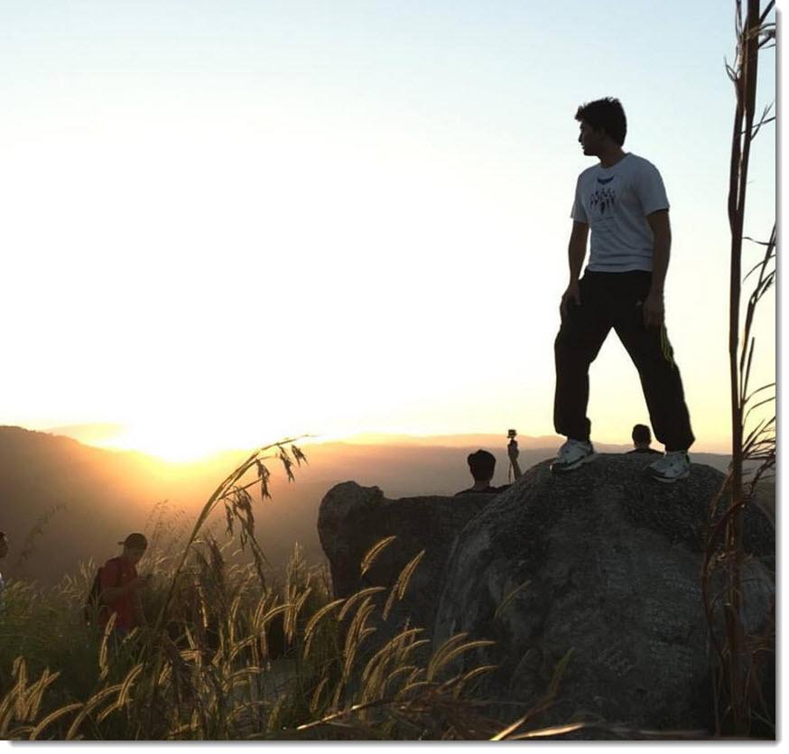 Riaz on a boulder